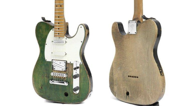 Francis Rossis battered Status Quo Fender Telecaster sells at auction